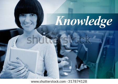 The word knowledge against teacher with tablet pc - stock photo