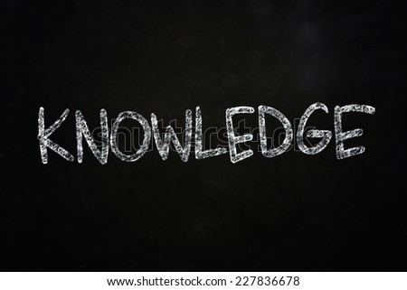 The word Knowledge written with chalk on blackboard