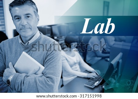 The word lab against teacher standing while holding a tablet pc - stock photo