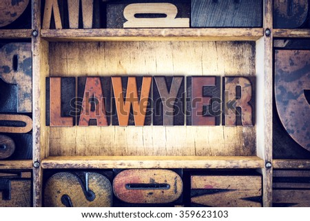 "The word ""Lawyer"" written in vintage wooden letterpress type."