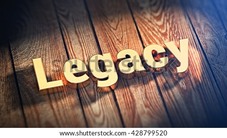 """The word """"Legacy"""" is lined with gold letters on wooden planks. 3D illustration image - stock photo"""