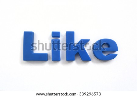 The word like spelled out in blue letters on a wooden background.