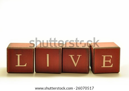 the word LIVE spelled out in rustic blocks - stock photo