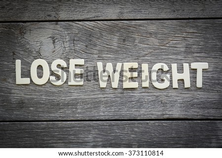 The word lose weight on the wooden floor