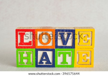 The word love and hate spelled with colorful alphabet blocks isolated on white background - stock photo