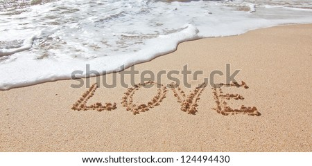 The word love in the sea on the beach in Valentine Day. Closeup. - stock photo