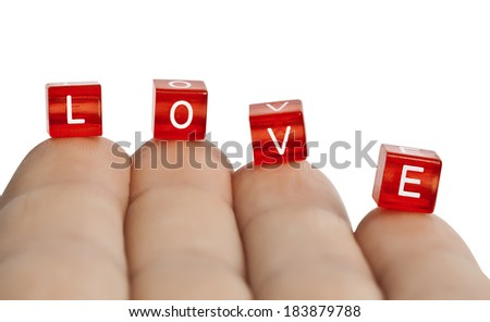 The word love of cubes on my fingertips