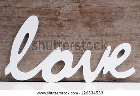 The word Love on a wooden background