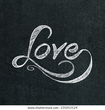 the word love on the chalkboard - stock photo