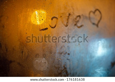 """The word """"Love"""" on the window in the rain - stock photo"""