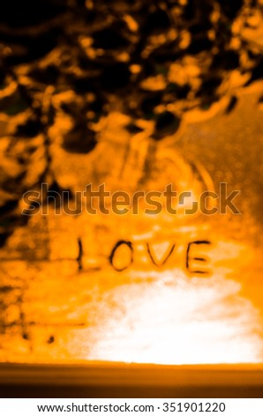 """The word """"Love"""" on the window in the rain,black and white,vertical photo - stock photo"""