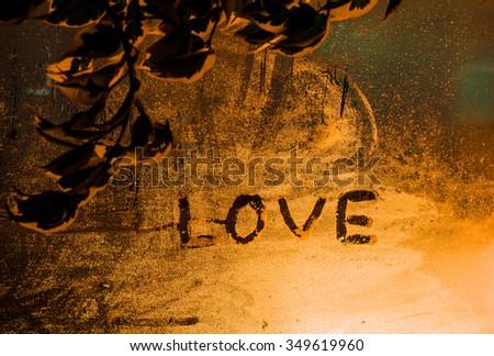 "The word ""Love"" on the window in the rain,horizontal photo - stock photo"