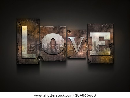"The word ""Love"". Random letterpress type on grunge background. - stock photo"