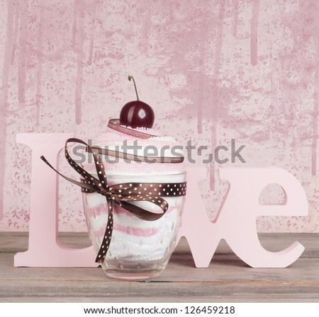 the word love with towel cupcake give away. Valentine or wedding card design - stock photo