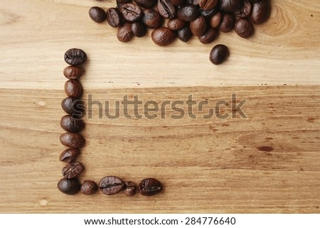 The word love written with coffee beans on wood background, Vintage style - stock photo