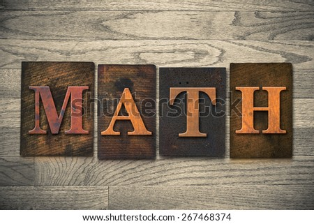 "The word ""MATH"" theme written in vintage, ink stained, wooden letterpress type on a wood grained background. - stock photo"