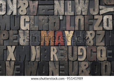 The word May written in antique letterpress printing blocks. - stock photo