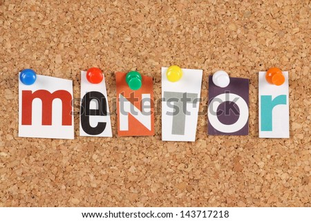 The word Mentor in cut out magazine letters pinned to a cork notice board. Mentors are seen as an investment in people via inspiration,motivation and the sharing of ideas and experiences.