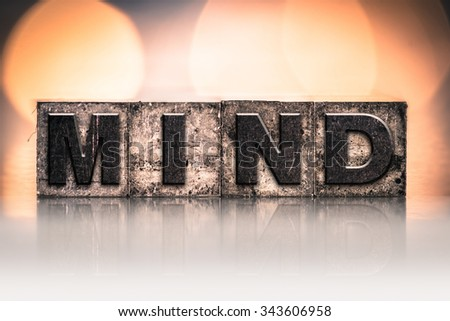 "The word ""MIND"" written in vintage ink stained letterpress type. - stock photo"