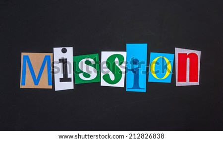 The word mission in cut out magazine letters on blackboard