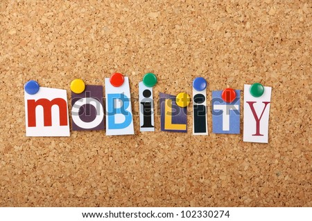 The word Mobility in cut out magazine letters pinned to a cork notice board