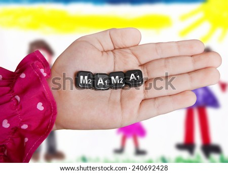 The word mom, composed of letters in a child's palm, on the background of children's drawing - stock photo