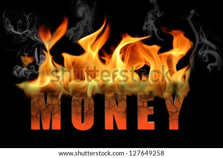 The word money is in flame text to convey many different messages and concepts about burning money.  Applies to business and industries as metaphors.  Black background.