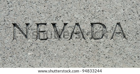 "The word ""Nevada"" carved into granite"