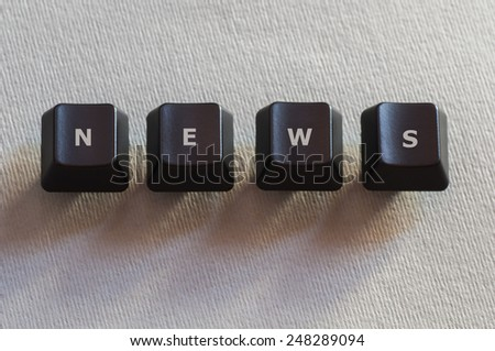 The word news made of four black computer keyboard buttons - stock photo