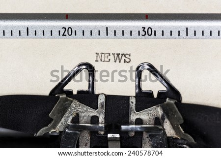 The word News written with old typewriter - stock photo