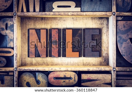 "The word ""Nile"" written in vintage wooden letterpress type."