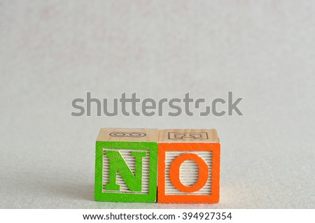 The word no spelled with alphabet blocks isolated on a white background - stock photo