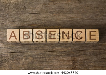 the word of ABSENCE on a wooden cubes - stock photo