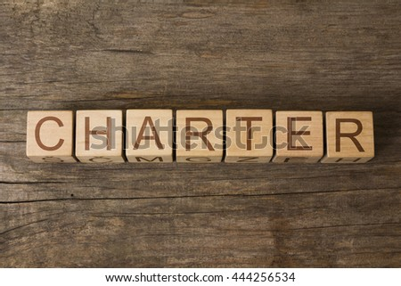 the word of CHARTER on wooden cubes - stock photo