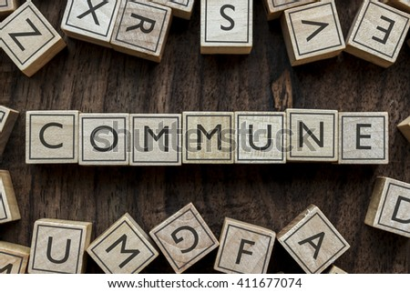 the word of COMMUNE on building blocks concept
