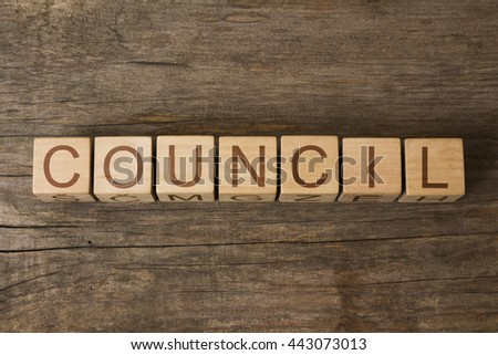 the word of COUNCIL on a wooden cubes