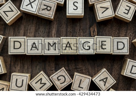 the word of DAMAGED on building blocks concept