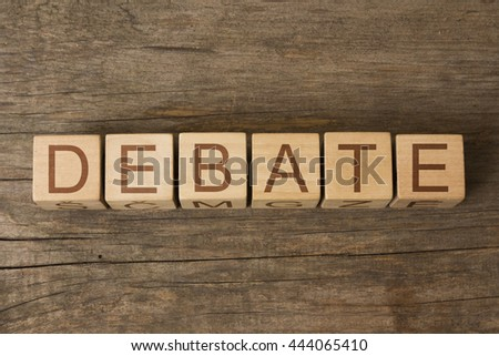 the word of DEBATE on wooden cubes