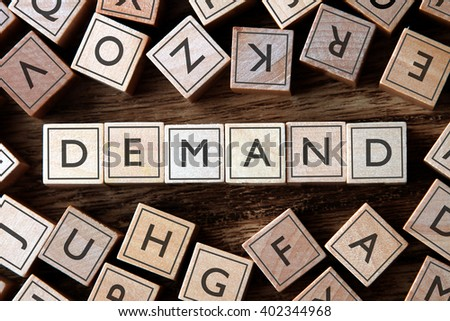 the word of DEMAND on building blocks concept - stock photo