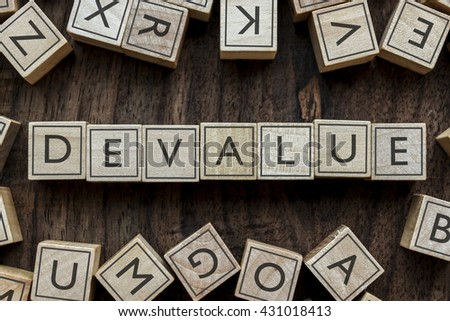 the word of DEVALUE on building blocks concept