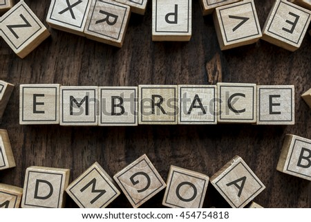 the word of EMBRACE on building blocks concept