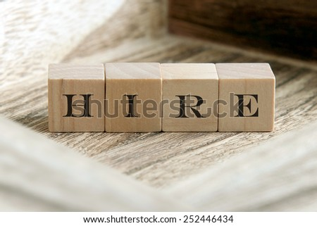 the word of HIRE on wooden cubes - stock photo