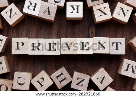 the word of PREVENT on cubes - stock photo