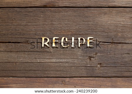 The word of Recipe on a wooden background