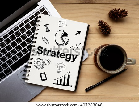"""The Word of  """"Strategy """" on notebook with Computer laptop and coffee. Business concept - stock photo"""