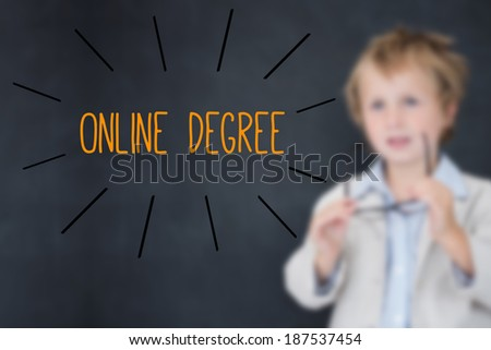The word online degree against schoolboy and blackboard - stock photo
