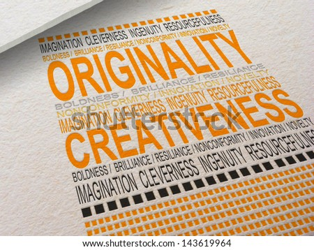 The word Originality letter pressed into paper with associated words around it. - stock photo