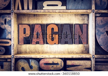 "The word ""Pagan"" written in vintage wooden letterpress type. - stock photo"