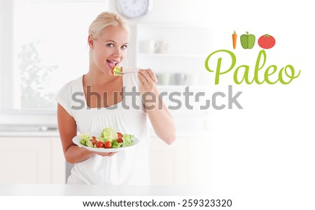 The word paleo against blonde woman eating a salad - stock photo
