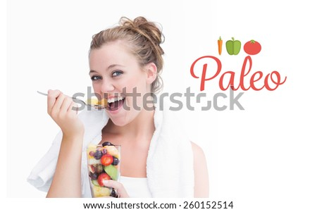 The word paleo against woman eating fruit and smiling - stock photo